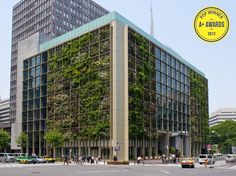 """NYC-based firm Kono Designs renovated Pasona's nine-story, 215,000 SF office with a double-skin green facade, offices, auditorium, cafeterias, rooftop garden, and urban farming facilities integrated with the building. The green space comprises 43,000 SF with 200 species, including fruits, vegetables, and rice. (The main lobby has a rice paddy—and a broccoli field!) """"It is the largest and most direct farm-to-table of its kind ever realized inside an office building in Japan,"""" says Kono."""