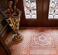 "Beautiful encaustic tiles enhance this handsome foyer. ""Bachelor Button"" wallpaper by #BradburyWallpaper"