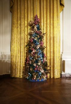 A Christmas tree stands in the East Room of the White House December 4, 2013 in Washington, DC. U.S. first lady Michelle Obama will host tod...