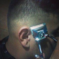manual clipper haircut in progress