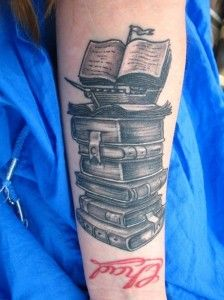 I like the way the books stack. maybe two of them and then the pages of the top one blowing away?