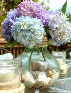 Coastalize a vase with rope and shells inside! http://www.completely-coastal.com/2015/05/diy-coastal-beach-vases-summer-crafts.html