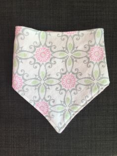 A personal favorite from my Etsy shop https://www.etsy.com/listing/262488019/pink-gray-and-green-printed-bibdana