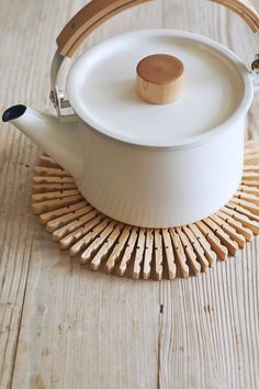 A Clever Homemade TrivetWhip up a Scandinavian-style table protector from–get this–wooden clothespins and floral wire. Oslo-born crafter Paul Lowe shares his easy how-to in Sweet Paul Eat and Make ($30; Houghton Mifflin Harcourt). Simply disassemble 40