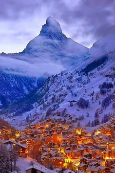 Swiss Alps.  What a fairytale village! Reminds me of Santa's Village in the Northpole. I can feel the warmth coming from the village amidst the towering Swiss Alps.