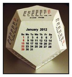 The 12-sided calendar is also known as a regular dodecahedron. This is a link to a free download of the pattern and origami instructions for 2012 calendar.