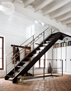 Style @ Home - modern cabin, industrial stair paired w/ herringbone brick floor (article Stephanie Whittaker; photog Jean Longpre; styling Nicola Marc)