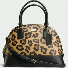 COACH DOMED SATCHEL IN OCELOT PRINT HAIRCALF BAG Printed haircalf  Inside zip pocket  Zip-closure, fabric lining  Handles with 4 3/4 drop  Longer, detachable strap with 21 1/2 drop for shoulder or   crossbody wear  12 1/2 (L) x 9 (H) x 5 1/2 (W)  MSRP: $395 Coach Bags Satchels