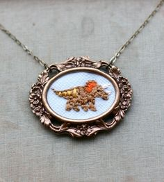 Mr. Triceratops - Hand-Embroidered Necklace   Jewelry Necklaces   Poppy and Fern   Scoutmob Shoppe   Product Detail