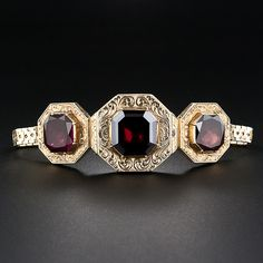 Antique 18K white and yellow gold hinged bracelet with garnets and white topaz circa mid-1800s.