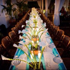 I don't like the long tables, but I love the blue silverware wraps, and orchid center piece :)