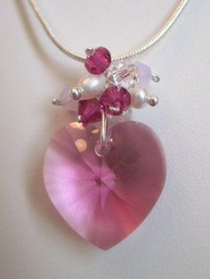 Celebrate your Special Event with this Beautiful Rose Pink faceted Heart (6228) Swarovski Crystal Pendant and Matching Earrings in Sterling silver.  Accented with fresh water white pearls, cyclamen op