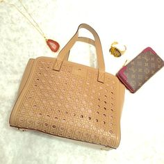 Kate Spade Perforated  Bag in excellent condition, pls check photos. handle is not really chipped off, just not perfect.  inside shows some signs of wear. Tan color. Perfect for any season. kate spade Bags