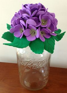 Top mason jars with cute & easy decorative foam flowers.