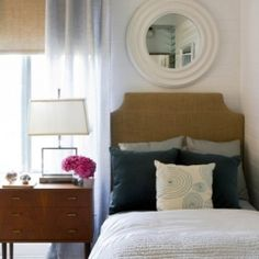 guest room -This simple bedroom is full of classy touches and contrasting geometrics
