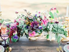 purple floral centerpieces - photo by Ashley Slater Photography http://ruffledblog.com/a-southern-winter-wedding-with-jewel-tones