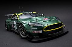 Aston Martin -- it's sounds like a nest of angry hornets amplified through Jimi Hendrix's amplifier. Aston Martin Dbr9, Aston Martin Lagonda, Aston Martin Vantage, Sports Car Racing, Sport Cars, Gt Cars, Race Cars, Le Mans, Automobile Companies