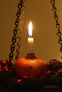 Pomegranate holds the first of the four advent candles!!! Bebe'!!! Simple elegant touch!!! Would look great with a rustic plaid and leather decor for the holidays!!!
