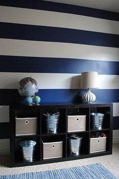 I love the dramatic stripes. And I'm really digging navy right now. (as is everyone apparently)~Ridge's room