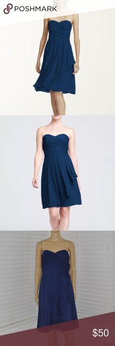 Short Crinkle Chiffon Dress with Front Cascade Short Crinkle Chiffon Dress with Front Cascade DAVID'S BRIDAL style# F14847 size: 8 color: marine (navy blue)  This strapless style is great for a bridesmaid and offers plenty of wear-again potential!   Ruching detail shapes a stunning sweetheart neckline that flatters any body type.  Crinkle chiffon flows to create a front cascade that adds dimension and romance.  Fully lined. Back zip. Imported polyester. Dry clean only.  @cjrose25  More…
