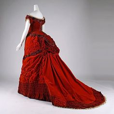 Red velvet Victorian bustled evening gown (circa 1875)  London.  Embroidered applique work, tucks, bows & lace.  Look at the amazing ruching along the hemline!