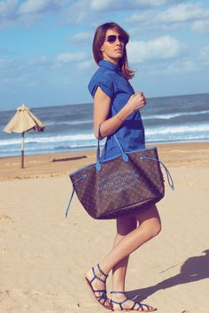 The infinite blue of a cloudless sky calls out for a beach style that can match the dazzling scenery.  The Louis Vuitton Summer collection will keep her looking radiant.