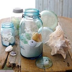MANZANITA OREGON IN A JAR! Blue mason jars filled with REAL local sand and a few REAL local sea pieces -shells and rocks- then topped with a cap. (Even get a small vial to seal sea water inside and drop inside).