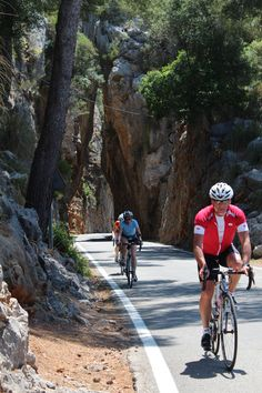 These guys have just ridden through the Cathedral Gap [a narrow separation of the rocks] on their way up Sa Colabra, Mallorca, Spain.  We just missed our own peloton - oops! THEBIKESHED-Tetbury.net