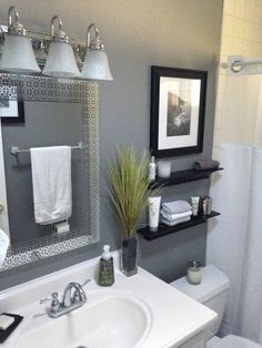 This colorful, small gray bathroom makeover can be done in just 1 weekend with Grant Gray paint, Weathered White paint, and a pretty wall stencil!