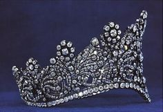 Empress Josephine's coronation diadem of silver and gold set with 1,040 diamonds, 1804. Given by Napoleon to Josephine especially for their coronation, the diadem is still in its original articulated mounting, its graceful widow's-peak shape designed to complement the simple Grecian coiffure favored by the empress. Van Cleef and Arpels, New York.