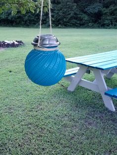 "DIY solar lantern.  Paint an old glass globe and insert a ""dollar store"" solar light.  Then hang with twine."