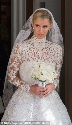 Mirror image: The 31-year-old hotel heiress (pictured) may have been inspired by Kate Middleton's iconic wedding gown, which was designed by Alexander McQueen head designer Sarah Burton