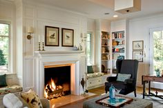 Love the window seats and corner book shelves flanking the fireplace. Design by TMS Architects with house located in Wolfeboro, US. My Living Room, Home And Living, Living Spaces, Living Area, Traditional Fireplace, Traditional House, Cozy Fireplace, Fireplace Ideas, Fireplace Design