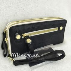 """NWT Steve Madden Black Double Zip Wristlet Wallet Authentic Steve Madden Large Black Double Zip Around Wristlet Wallet  • Dimensions: 8"""" W x 4"""" H x 1.5"""" with removable wrist strap • Zip around section #1: Five card slots, an ID compartment & 4 full length slip pockets • Zip around section #2: One zipper pocket with 2 expandable compartments on each side & 2 full length slip pockets • Exterior: 1 zipper pocket • Hardware: Gold Tone   I have more STEVE MADDEN, check out my other items!  ❌ NO…"""