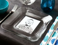Turn plates into place cards. Simply set clear plates atop photographs of each guest.