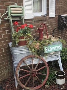 Double wash tub with wringer and wagon wheel details flower garden shed ideas