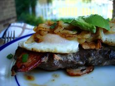 #paleo Fancy Steak & Eggs: 1 elk round steak (or steak of your choice); 1-2 pieces of bacon; 2 eggs; 1/2 yellow onion, sliced thin; 1/2 teaspoon dried basil; salt and pepper, to taste; avocado, to top; fat of choice – used bacon fat