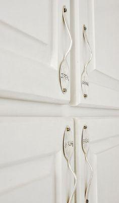 spoons into cupboard handles ...