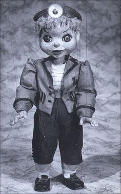 """""""Torchy,Torchy the Battery Boy, I'm a walky, talky toy"""".  How ugly is he?  Liked him at the time. Enough to give a child nightmares now"""
