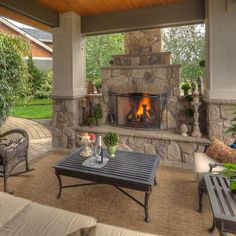 Outdoor Covered Patio With Stone Fireplace And Chair