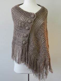 The bohemian statement of the season, this full length shawl is wrap-around and button fastened. Made from soft acrylic for a luxurious cover up, this piece is the crowning touch to any outfit. Crochet Shawls And Wraps, Knitted Shawls, Crochet Scarves, Crochet Clothes, Crochet Buttons, Knit Or Crochet, Crochet Stitches, Crochet Hooks, Shawl Patterns