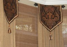 Great idea for when you don't want a continuous treatment on a bow/bay window. Panel Valances