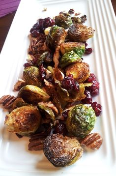 Brussels sprouts with pecans and cranberries. Vegan side dish for Thanksgiving.