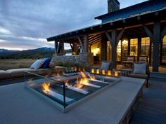 spectacular modern outdoor fireplace glass walls gravel patio design ideas
