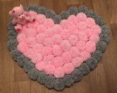Redonda y esponjosa alfombra de pompones