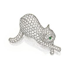 PLATINUM, DIAMOND & EMERALD BROOCH, TIFFANY & CO. Designed as a cat set with numerous round diamonds weighing approx 5.60 cts, with an oval-shaped emerald eye, signed Tiffany & Co., France.