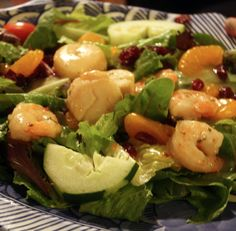 Key West Seafood Salad from The Sanibel Fish House Restaurant on Sanibel Island, FL   Sauteed shrimp and scallops over spring mix with mandarin oranges and craisins. Dressed with pineapple-magi vinaigrette.