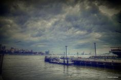 Brooklyn far in the clouded distance.