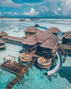 Overwater Villa with a slide at the Gili Lankanfushi Maldives. Vacation Places, Honeymoon Destinations, Dream Vacations, Vacation Spots, Places To Travel, Honeymoon Ideas, Romantic Vacations, Vacation Packages, Italy Vacation