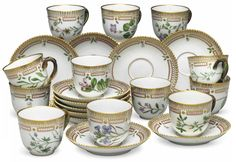 TWELVE ROYAL COPENHAGEN PORCELAIN 'FLORA DANICA' BOTANICAL DEMITASSE CUPS AND ELEVEN SAUCERS 20TH CENTURY, BLUE WAVE MARK AND GREEN PRINTED MARKS, PATTERN NO. 20, SHAPE NO. 3618 Each finely painted in colors with a specimen flower named in Latin on the underside, the painted border with bosses suspending leaf sprig